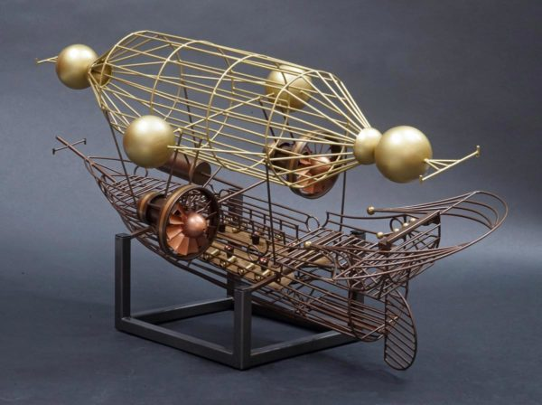 """the metal sculpture """"Aerial"""" by Lon Walters at Rong Wranch art. A metalwork depiction of a wire frame galleon shaped dirigible"""